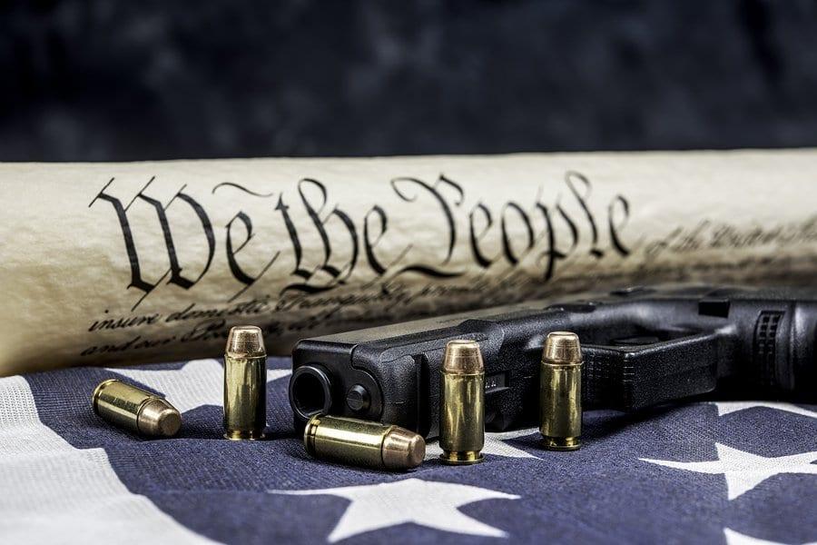 bigstock-A-handgun-with-bullets-symboli-191723419 | DSC ...